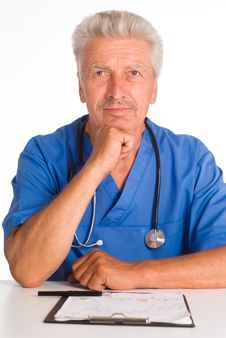 Free Doctor At Table Royalty Free Stock Photos - 20856178