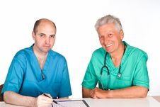 Free Two Doctors At Table Stock Photography - 20856442