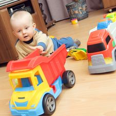 Free Baby Boy And Trucks Stock Photo - 20857190