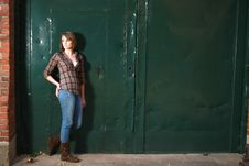 Free Younf Woman Standing By Green Doors Stock Images - 20859594