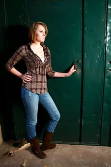 Free Young Woman By A Green Door Royalty Free Stock Photo - 20859595