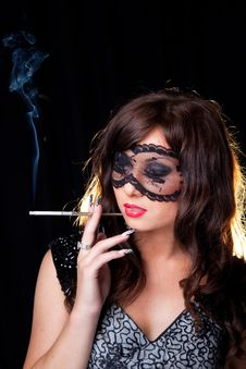 Smoking Lady With Lacy Mask On Black Stock Photography
