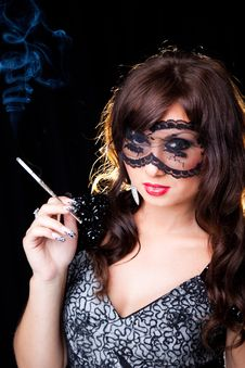 Smoking Lady With Lacy Mask On Black Royalty Free Stock Photo