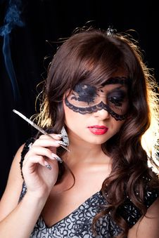 Smoking Lady With Lacy Mask On Black Stock Photo