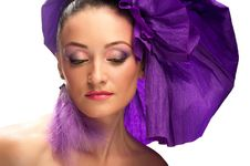 Free Portrait Of A Woman In A Purple Hat Royalty Free Stock Image - 20864476