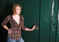 Free A Young Woman By A Green Door Royalty Free Stock Photos - 20866488