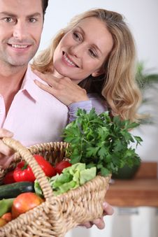 Free Couple With Vegetable Basket Stock Images - 20866884