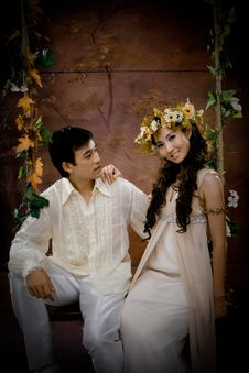 Portrait Of Young Couple In Antique Dress Royalty Free Stock Images