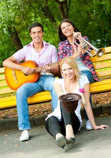 Free Young Friends Play The Guitar And Trumpet Royalty Free Stock Image - 20874396