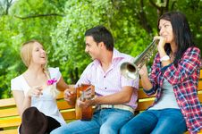 Free Young Friends Play The Guitar And Trumpet Stock Image - 20874451
