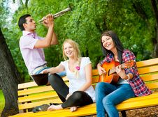 Free Young Friends Play The Guitar And Trumpet Royalty Free Stock Photography - 20874487