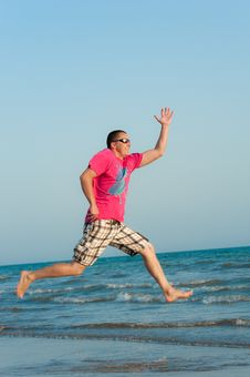 Free Young Man Jumping In The Ocean Royalty Free Stock Images - 20874959