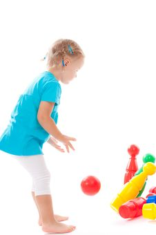 Free Little Child Is Playing Bowls In Studio Stock Photos - 20875433