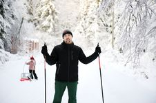 Free Young Father Enjoy Nordic Skiing With His Daughter Stock Image - 20876781