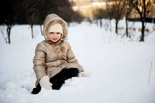 Child Girl In Winter Coat With Hood Plays In Snow Stock Images