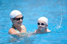 Free Mother And Baby Are Swimming In Swimming Pool Royalty Free Stock Photography - 20880567