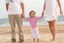 Free Family Parents And Baby Walking On The Beach Stock Photo - 20880750
