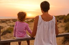 Free Baby With Mum Is Looking Sunset Stock Photos - 20880833