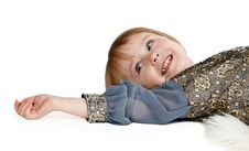 Little Girl Lying On The Floor In The Studio Stock Photography