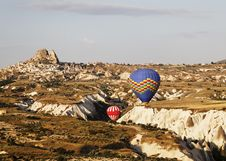 Blue Red Hot Air Balloons Navigate Gorge, Uchisar Stock Images
