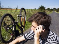 Free Young Cyclist Calling For Help Royalty Free Stock Image - 20882146