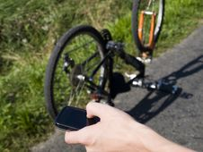 Free Young Cyclist Calling For Help Royalty Free Stock Images - 20882179