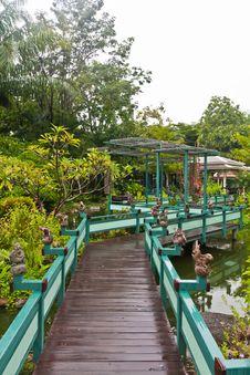 Wooden Bridge In Green Park Vertical Stock Photo