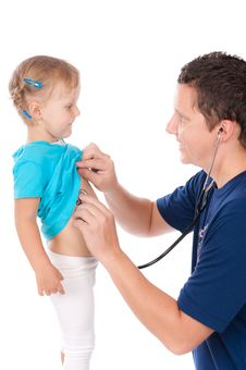 Man With Stethoscope Testing Child Royalty Free Stock Photography