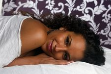 Free Latin Girl Smiling On Bedsheets Royalty Free Stock Image - 20884706