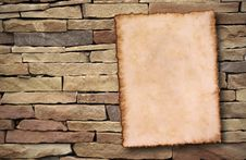Old Paper On Brick Wall Stock Image