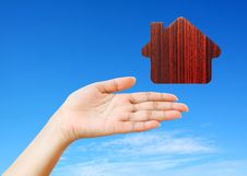 Hand And Icon House Royalty Free Stock Image