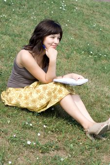 Free Girl Sitting On Grass Stock Images - 20887434