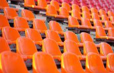 Free Empty Orange Stadium Seats Royalty Free Stock Photos - 20890318