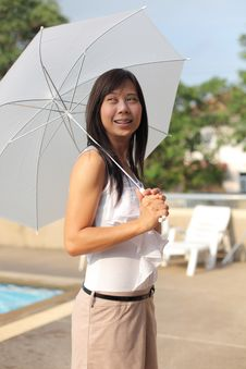 Women And Umbrella Beside Swimming Pool Stock Photo