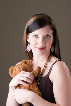Free Pretty Brunette Girl With Teddy Bear Royalty Free Stock Images - 2090149