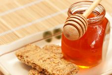 Free Honey With Cereal Butter And Wood Dipper Royalty Free Stock Images - 20902489