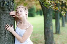 Outdoors Portrait Of Happy Young Woman Stock Photo