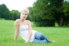Free Beautiful Attractive Woman Sitting On A Green Gras Stock Images - 20905154