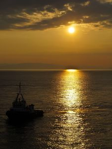 Free Carrier Ship At Sunset In The Sea Royalty Free Stock Images - 20909269