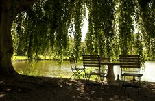 Free Table And Chairs Next To A Pond Royalty Free Stock Photo - 20911245