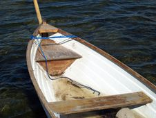 Small Fishing Boat Dory Rowboat On Water Stock Images