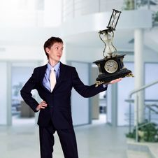Free Businessman In Office Holding Clock Pyramid Stock Photo - 20911730
