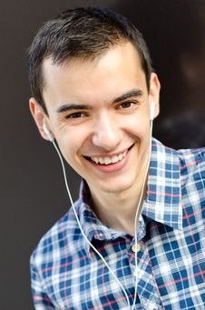 Free Young Man Listening To Music And Smiling Stock Photos - 20913273