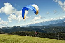 Free Paraglider Flying Over The Italian Alps Royalty Free Stock Image - 20915116