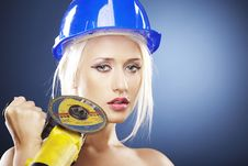 Free Portrait Of A Beautiful Model With Angle Grinder Royalty Free Stock Image - 20918836