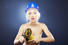 Free Blonde Model Holds An Angle Grinder. Stock Images - 20919204