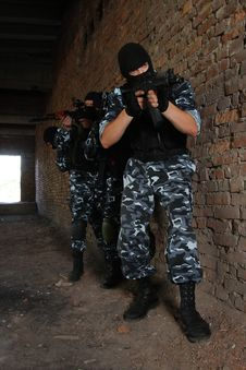 Group Of Soldiers In Black Masks With Guns Royalty Free Stock Photos