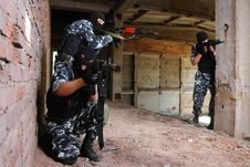 Soldiers In Black Masks Targeting With Guns Stock Images
