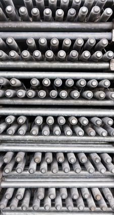 Many Layers Of Machine Bolts Vertical Royalty Free Stock Image