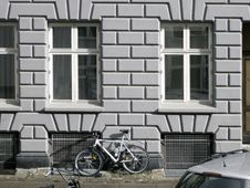 Old City House Facade With A Bike Under Windows Royalty Free Stock Photography